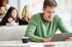 Man looking at loan on tablet