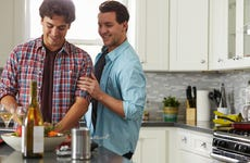 Gay couple cooking in the kitchen