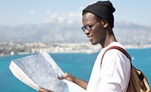 Student looks at a map while studying abroad