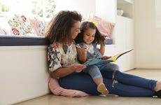 Mother reads to her young daugher