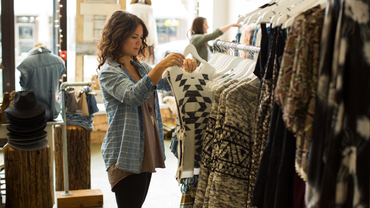 Two women shop in a clothing store