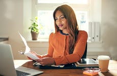 Young female entrepreneur working in home office