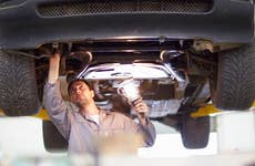 Auto mechanic inspecting a car