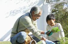 A grandfather and his grandson spend some quality time together gardening.