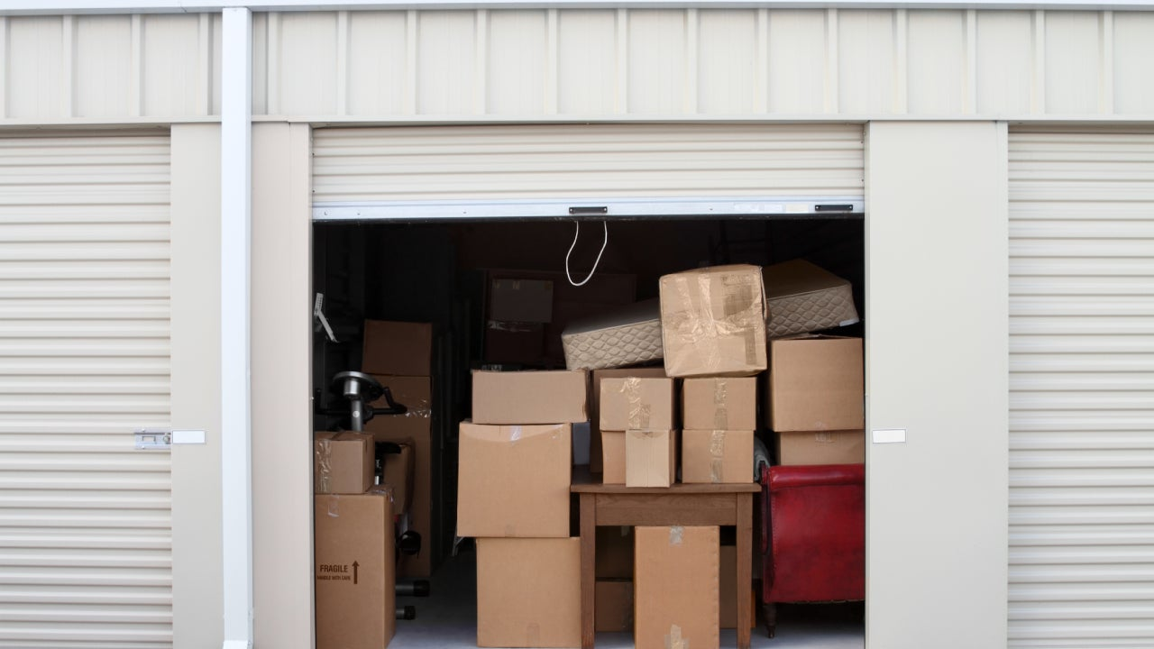 A storage unit full of cardboard boxes.