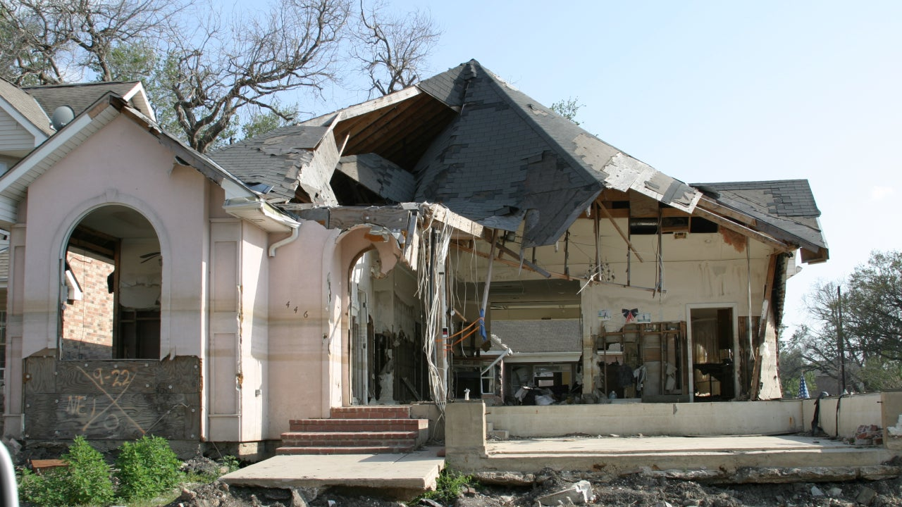The remains of a home after a natural disaster has swept through and destroyed the roof.