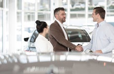 Car dealership with customers