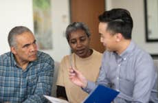 An older couple sits down with a consultant to talk about their policy.