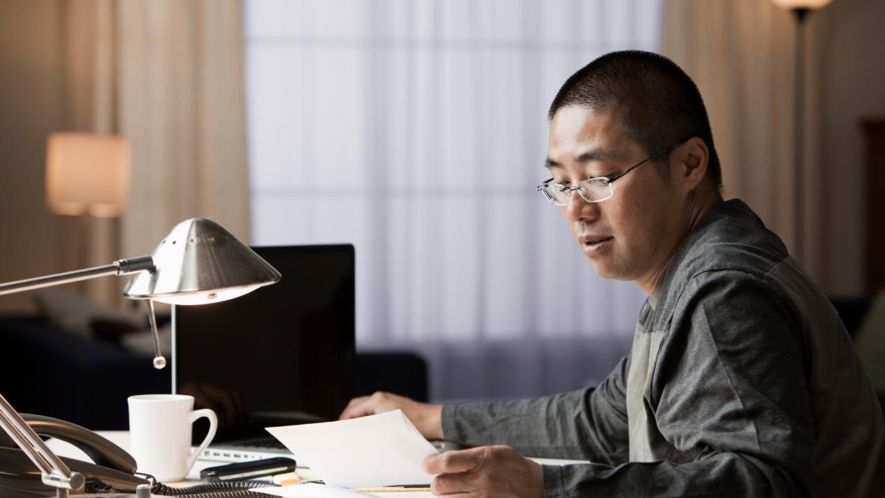 Man reviewing his bills at a desk
