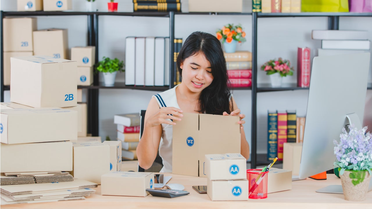 Woman packages orders for her small business