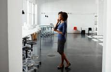 Woman talking on phone in office