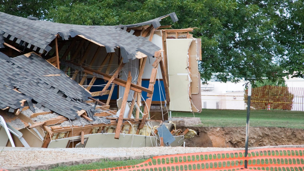 A house in shambles from a sinkhole.