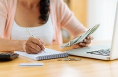 Woman calculating budget and payments