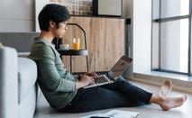Man checks finances on laptop