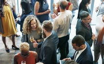 Diverse crowd of business people mingling