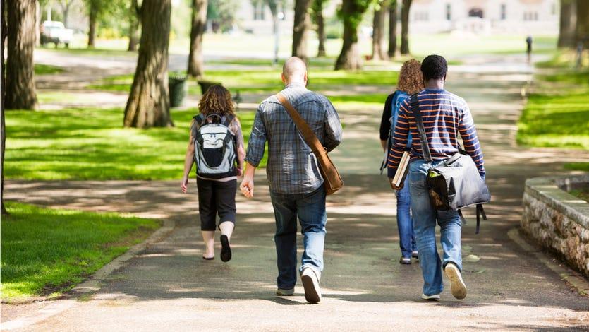 Students walk through college campus.