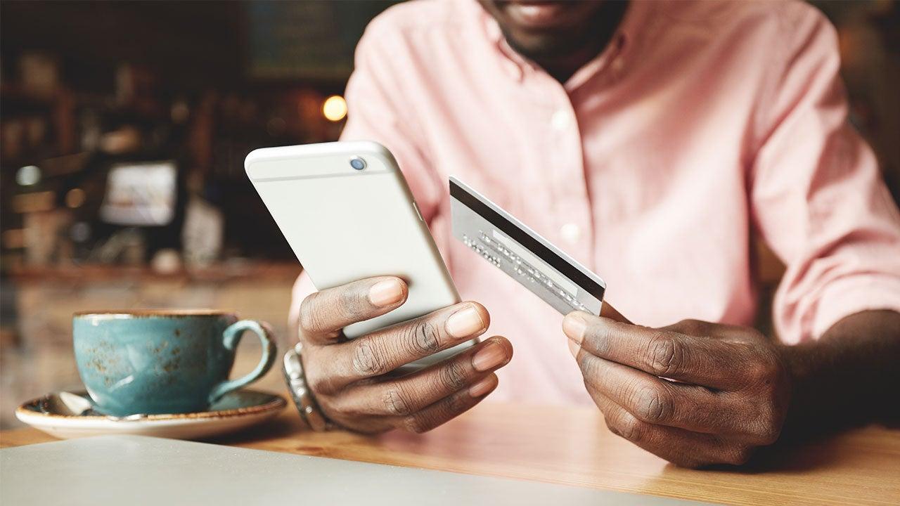 Man paying credit card with balance transfer credit card