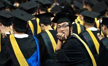 University student sits a graduation