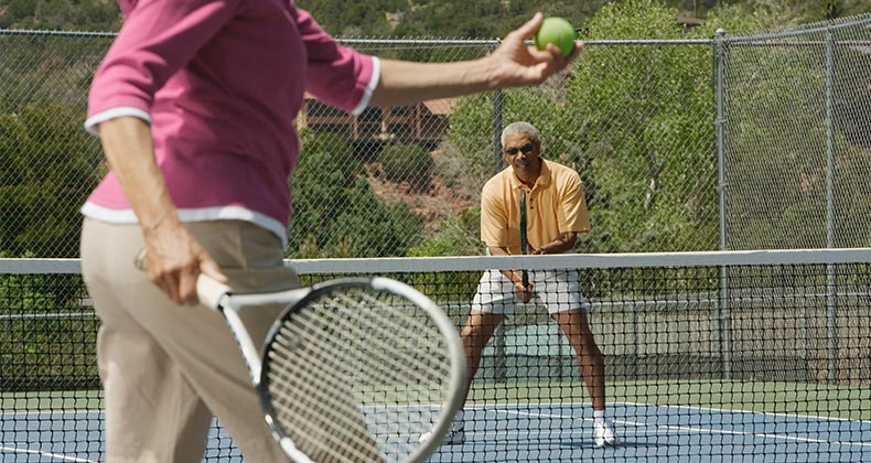 Couple playing tennis together   ERproductions Ltd/Getty Images