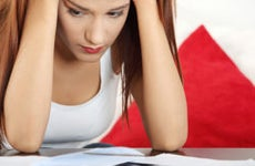 Young woman stressed over bills