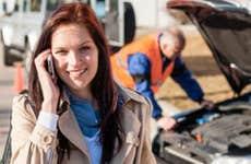 Female motorist getting roadside assistance © CandyBox Images/Shutterstock.com