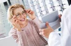 Mature woman trying on eyeglasses in optical shop   Iakov Filimonov/Shutterstock.com