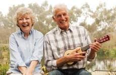 Couple laughing while playing ukelele   David Jakle/Getty Images