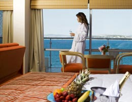 Woman in hotel room with water view