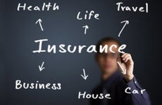 Business man writing insurance concept, © Dusit/Shutterstock.com