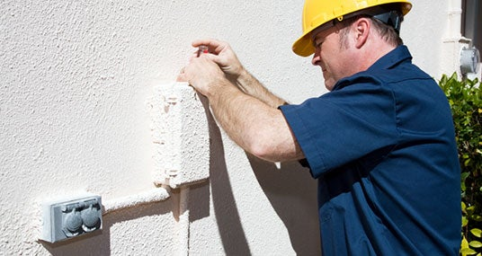Home inspector opening electrical box © Lisa F. Young/Shutterstock.com