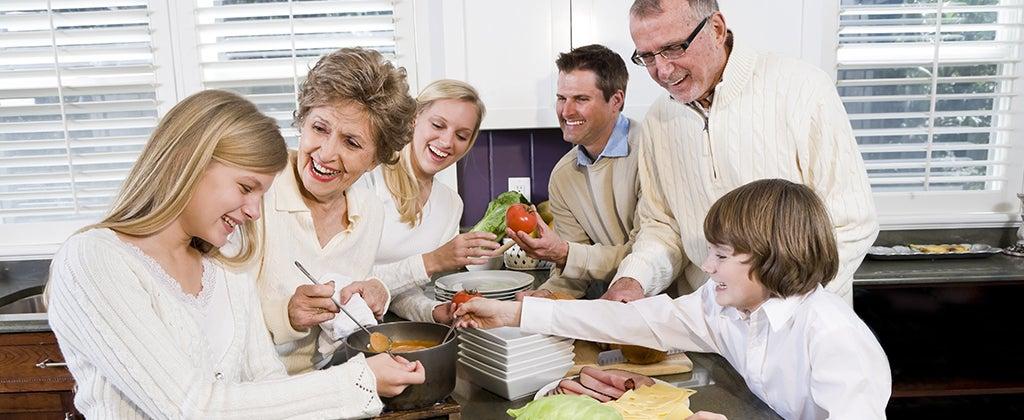 Three generations in the kitchen preparing a meal © Golden Pixels LLC/Shutterstock.com