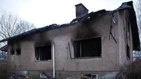 How can I buy the drug dealer's burned-out house next door?
