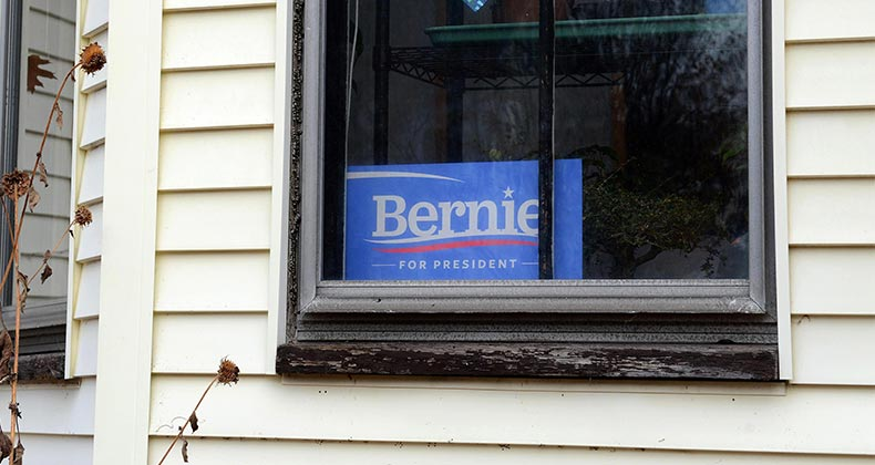 'Bernie Sanders for President' sign in house window   Darren McCollester/Getty Images