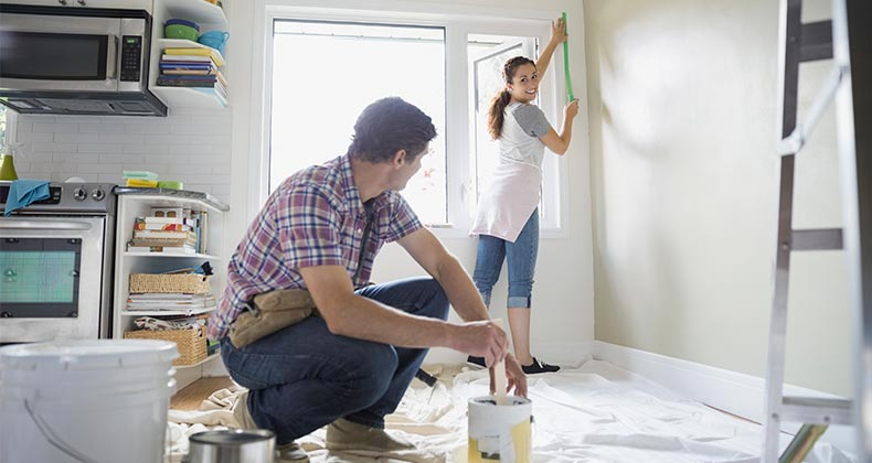 Couple painting kitchen   Hero Images/Getty Images