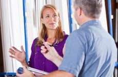 Woman talking to insurance adjuster © iStock