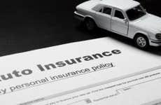 Toy car on auto insurance paperwork © Ilya Zlatyev/Shutterstock.com