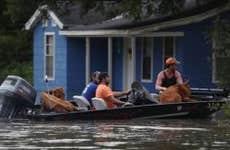 Louisiana flood victims on boat   Joe Raedle/Getty Images