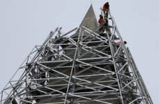 Workers atop Washington Monument   Mark Wilson/Getty Images