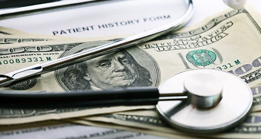 Stethoscope on 100 bills with history form © isak55/Shutterstock.com