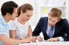 Consultant with young couple reviewing documents © Deklofenak/Shutterstock.com
