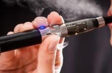 Woman smoking e-cigarette © scyther5/Shutterstock.com