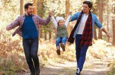 Male couple walking with young daughter