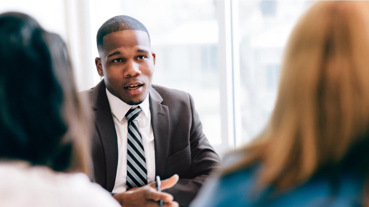 Financial adviser speaking to his clients