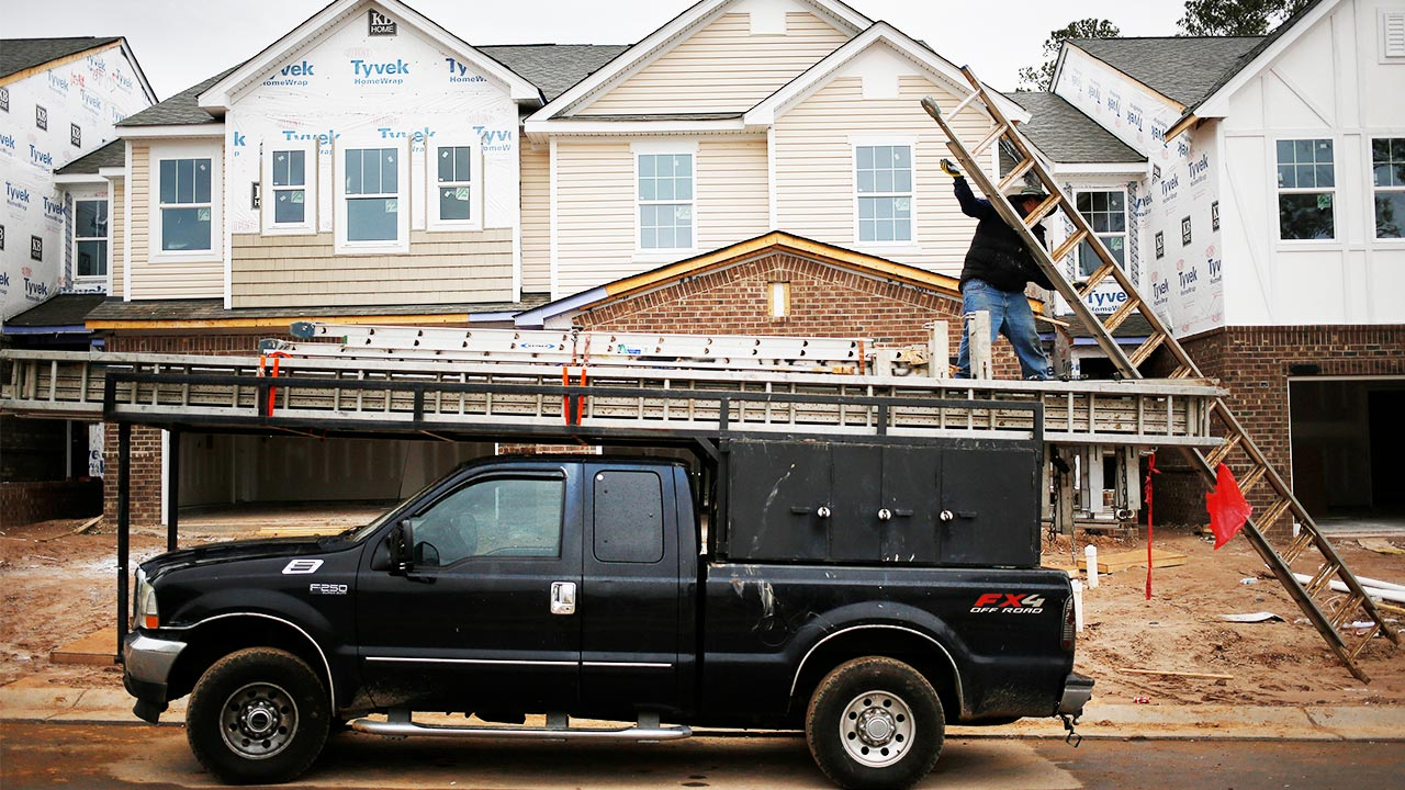 Builders outside of a home construction site