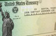 Tax refund check with green background © karen roach/Shutterstock.com