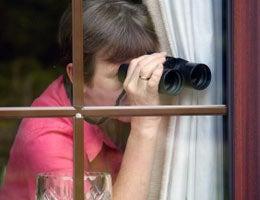 Nosy woman spying on neighbors