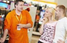 Salesman showing couple a TV © Dmitry Kalinovsky/Shutterstock.com