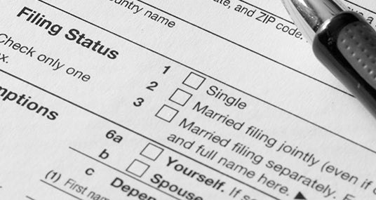Close up of Form 1040, emphasis on filing status