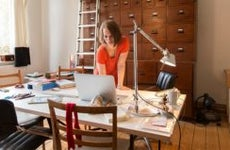Woman working in home office   Simon Ritzmann/Getty Images