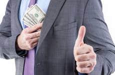 man in suit receiving extra money ©Drazen/Shutterstock.com